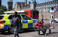 Pictured: An old man sleeps on a bench next to a police car opposite Cardiff Castle Thursday 25 May 2017<br />Re: Preparations for the UEFA Champions League final, between Real Madrid and Juventus in Cardiff, Wales, UK.