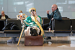 St. Patrick  (aka Johnny Murphy Artastic) pictured here sharing his bag of Jelly snakes in Dublin Airport Terminal Two as he arrives for the annual  St Patrick's Festival 2011 Pic: Robbie Reynols CPR.