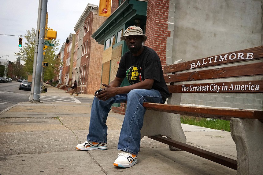 James Lewis, 37 waits for a bus in the Hollins Market area of Baltimore, one of the blighted suburbs that Hillary Clinton referred to in the first major speech of her candidacy for President. April 30, 2015. to go with Nick O'Malley story.  photo by Trevor Collens