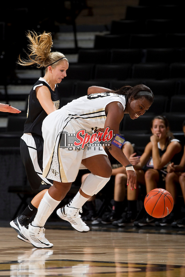 Asia Williams (33) of the Wake Forest Demon Deacons fights for a loose ball in front of Madison Floyd (10) of the Anderson Trojans at the LJVM Coliseum on October 29, 2012 in Winston-Salem, North Carolina.  The Demon Deacons defeated the Trojans 88-53.    (Brian Westerholt/Sports On Film)