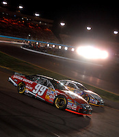 Apr 22, 2006; Phoenix, AZ, USA; Nascar Nextel Cup driver Carl Edwards of the (99) Office Depot Ford Fusion passes Jamie McMurray during the Subway Fresh 500 at Phoenix International Raceway. Mandatory Credit: Mark J. Rebilas-US PRESSWIRE Copyright © 2006 Mark J. Rebilas..