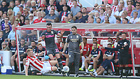 Leeds United's Jack Harrison is tackled by Stoke City's Nathan Collins in front of the dug-out<br /> <br /> Photographer Stephen White/CameraSport<br /> <br /> The Premier League - Stoke City v Leeds United - Saturday August 24th 2019 - bet365 Stadium - Stoke-on-Trent<br /> <br /> World Copyright © 2019 CameraSport. All rights reserved. 43 Linden Ave. Countesthorpe. Leicester. England. LE8 5PG - Tel: +44 (0) 116 277 4147 - admin@camerasport.com - www.camerasport.com
