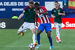 Fausto Tienza of Club Atletico Osasuna competes for the ball with Thomas Partey of Atletico de Madrid during the match of La Liga between  Atletico de Madrid and Club Atletico Osasuna at Vicente Calderon  Stadium  in Madrid, Spain. April 15, 2017. (ALTERPHOTOS / Rodrigo Jimenez)