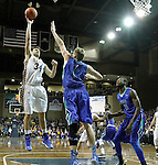SIOUX FALLS, SD - NOVEMBER 30:  Keaton Moffitt #12 from South Dakota State University takes the ball to the basket past Bernard Thompson #?? and Marc-Eddy Norelia #25 from Florida Gulf Coast in the second half of their game Sunday afternoon at the Sanford Pentagon in Sioux Falls. (Photo by Dave Eggen/inertia)