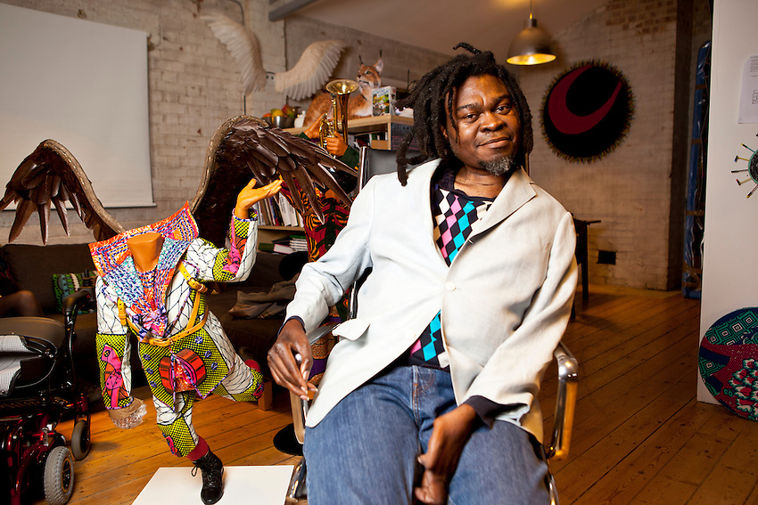 "Yinka Shonibare, MBE, (born 1962) is a British-Nigerian artist living in the UK. He readily acknowledges physical disability as part of his identity. Yinka moved to Lagos, Nigeria when he was three. At 16, he returned to Britain to do his A-levels.[2] After A-levels he went to art school. Shonibare contracted transverse myelitis, an inflammation across the spinal cord,[3] at the age of seventeen, which resulted in a long term physical disability. Shonibare's most famous work is ""Nelson's Ship In A Bottle"" which is on top of the fourth plinth at Trafalgar Square."