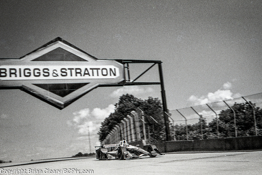 ELKHART LAKE, WI - June 23, 2017: (EDITOR'S NOTE: Photo taken on 35mm black and white film with vintage 35mm rangefinder camera) Takuma Sato, of Japan, drives the #26 Honda IndyCar on the track during practice for the Kohler Grand Prix Verizon IndyCar race at Road America on June 23, 2017 in Elkhart Lake, Wisconsin. (Photo by Brian Cleary/BCPix.com)