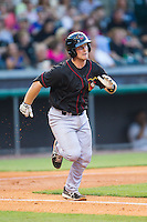 Brian Holberton (10) of the Quad Cities River Bandits hustles down the first base line against the Bowling Green Hot Rods at Bowling Green Ballpark on July 26, 2014 in Bowling Green, Kentucky.  The River Bandits defeated the Hot Rods 9-2.  (Brian Westerholt/Four Seam Images)