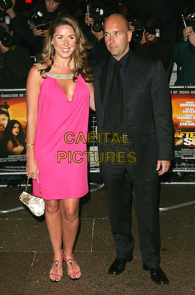 "CLAIRE SWEENY - SWEENEY & BOYFRIEND.Premiere of ""After The Sunset"", Vue Cinema, Leicester Square, London.November 2nd, 2004.full length girlfriend pink dress flip flops strappy sandals plunging neckline purse bag black pinstripe suit.www.capitalpictures.com.sales@capitalpictures.com.©Capital Pictures."