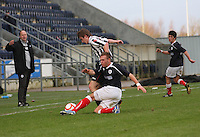 Kyle Turnbull tackles Kieran Doran at the Falkirk v St Mirren  Scottish Football Association Youth Cup 4th Round match played at the Falkirk Stadium, Falkirk on 16.12.12.