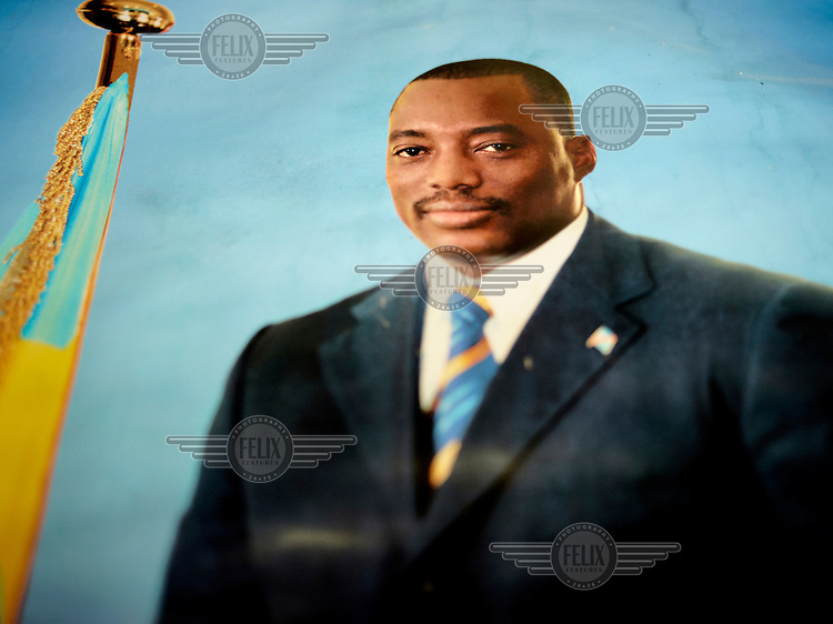 A poster with the president in the Democratic Republic of Congo (D.R.Congo) Mr. Joseph Kabila, Born 1971. He has been president of the country since January 2001 when he took office ten days after his father, President Laurent-Desire Kabila was killed by his own bodyguards.