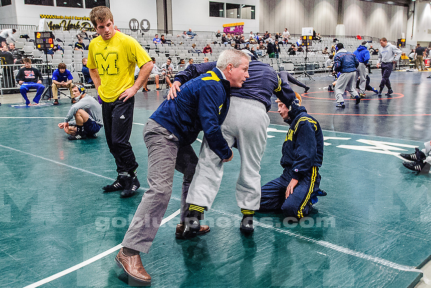 The University of Michigan wrestling team competes at the 2013 Cliff Keen wrestling tournament, at the Las Vegas Convention Center, Las Vegas, Nev., on December 6, 2013.""
