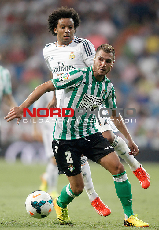 Real Madrid's Marcelo Vieira (b) and Betis' Javier Chica (f) during La Liga match.August 18,2013. Foto © nph / Acero)