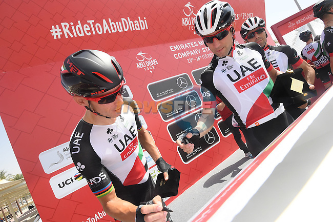 UAE Abu Dhabi team riders sign on before the start of Stage 1 Emirates Motor Company Stage of the 2017 Abu Dhabi Tour, running 189km from Madinat Zayed through the desert and back to Madinat Zayed, Abu Dhabi. 23rd February 2017<br /> Picture: ANSA/Matteo Bazzi | Newsfile<br /> <br /> <br /> All photos usage must carry mandatory copyright credit (&copy; Newsfile | ANSA)