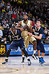 Mawdo Sallah (1) and Will Miller (11) of the Mount St. Mary's Mountaineers box out Aaron Rountree III (33) during first half action at the LJVM Coliseum on November 26, 2014 in Winston-Salem, North Carolina.  The Demon Deacons defeated the Mountaineers 83-49.   (Brian Westerholt/Sports On Film)