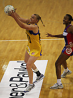 Pulse captain Cushla Lichtwark takes a pass under pressure from Pamela Cookey during the ANZ Netball Championship match between the Central Pulse and Northern Mystics, TSB Bank Arena, Wellington, New Zealand on Monday, 4 May 2009. Photo: Dave Lintott / lintottphoto.co.nz