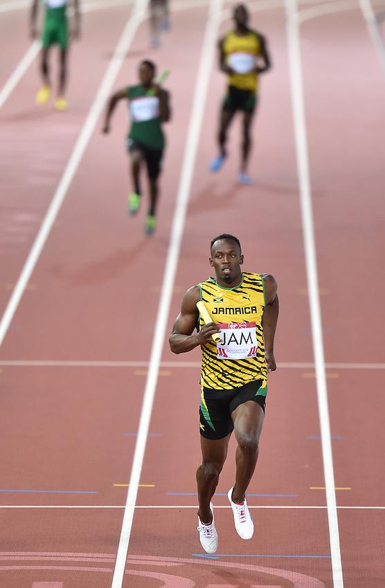 Jamaica's Usain Bolt during the men's 4x100m relay heat 2<br /> <br /> Photographer Chris Vaughan/CameraSport<br /> <br /> 20th Commonwealth Games - Day 9 - Friday 1st August 2014 - Athletics - Hampden Park - Glasgow - UK<br /> <br /> &copy; CameraSport - 43 Linden Ave. Countesthorpe. Leicester. England. LE8 5PG - Tel: +44 (0) 116 277 4147 - admin@camerasport.com - www.camerasport.com