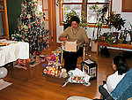 Woman opening christmas gifts