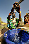 A girl obtains water from a community well in the Habile Camp for internally displaced persons outside the village of Koukou Angarana, Chad. Some 28,000 people live in precarious conditions in this camp. More than 180,000 residents of eastern Chad have been displaced by violence spilling over from neighboring Darfur, inter-ethnic conflict, and fighting between rebels and the Chadian government.