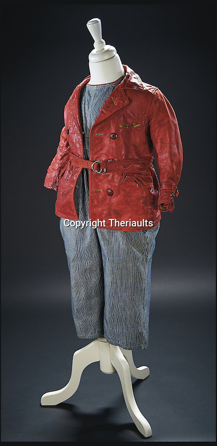 BNPS.co.uk (01202 558833)<br /> Pic: Theriaults/BNPS<br /> <br /> Shirley Temple's aviator costume from the 1934 film 'Bright Eyes'.<br /> <br /> The costumes worn by childhood movie star Shirley Temple during her Hollywood career make up a long-lost £1.5m collection belonging to the late actress.<br /> <br /> The curly-haired performer's parents made it a condition that she got to keep all of her outfits after filming rather than return them to the movie studios.<br /> <br /> The child costumes, that include the iconic red and white polka-dot dress the then six year old wore in her breakthrough role in the 1934 flick 'Stand Up and Cheer', have been locked away in a vault at her home for 75 years. They are being sold in Maryland, US.