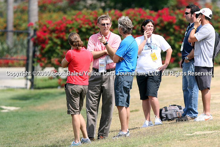 21 August 2009: WPS official Thom Meredith (in pink) talks with United States Women's National Team head coach Pia Sundhage (SWE) (center) and assistant coach Hege Riise (NOR) (left). The Los Angeles Sol held a training session at the Home Depot Center in Carson, California one day before playing Sky Blue FC in the inaugural Women's Professional Soccer Championship Game.