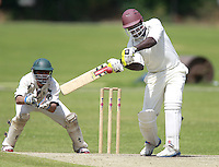 Leroy Shepherd bats for South Hampstead during the Middlesex County Cricket League Division Three game between North London and South Hampstead at Park Road, Crouch End on Sat June 21, 2014.