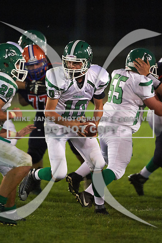 Pembroke Dragons quarterback Reid Miano (10) drops back against the Attica Blue Devils at Attica Central School on September 11, 2015 in Attica, New York.  Attica defeated Pembroke 36-0.  (Copyright Mike Janes Photography)