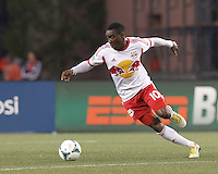 New York Red Bulls midfielder Lloyd Sam (10) wheels around. In a Major League Soccer (MLS) match, the New England Revolution (blue) tied New York Red Bulls (white), 1-1, at Gillette Stadium on May 11, 2013.