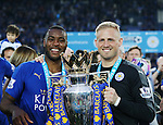 Leicester's Wes Morgan and Kasper Schmeichel celebrate with the trophy during the Barclays Premier League match at the King Power Stadium.  Photo credit should read: David Klein/Sportimage
