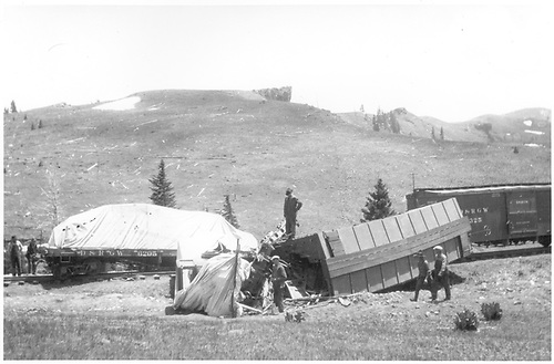 A box car has derailed and turned on its side, perhaps on Marshall Pass, while a loaded flatcar and another boxcar are nearby.<br /> D&amp;RGW  Marshall Pass ?, CO