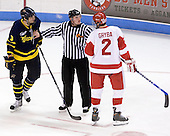 Kyle Bigos (Merrimack - 3) and Eric Gryba (BU - 2) were seperated by the linesman. - The Boston University Terriers defeated the Merrimack College Warriors 6-4 on Saturday, November 14, 2009, at Agganis Arena in Boston, Massachusetts.