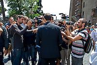 Il sindaco Ignazio Marino circondato dai giornalisti fuori del Campidoglio.<br /> Mayor of Rome Ignazio Marino surrounded by journalists outside his office at Capitol Hill