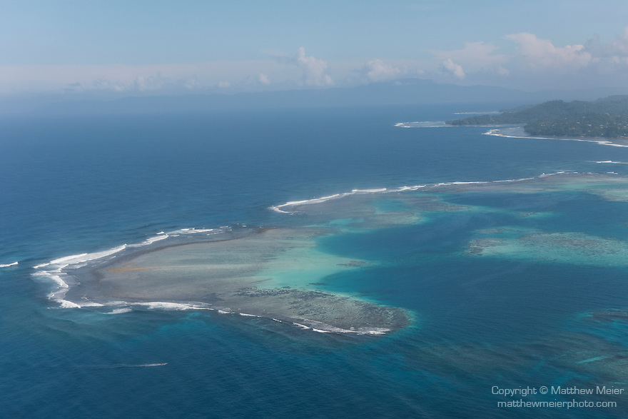 Ghizo Island, Solomon Islands; an aerial view of the offshore coral reef structure on approach to the airport at Gizo