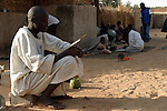 Talibes learning coranic versets outside the house of the marabout in Maradi, Niger. In Niger, coranic schools still exist and are very traditional. Talibe, pupils, even go and beg for money and food in the afternoon in order to pay the marabout.