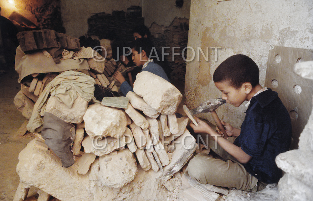 In Casablanca, Morocco, children are employed to shape intricate stones to be used in mosaics. - Child labor as seen around the world between 1979 and 1980 - Photographer Jean Pierre Laffont, touched by the suffering of child workers, chronicled their plight in 12 countries over the course of one year.  Laffont was awarded The World Press Award and Madeline Ross Award among many others for his work.