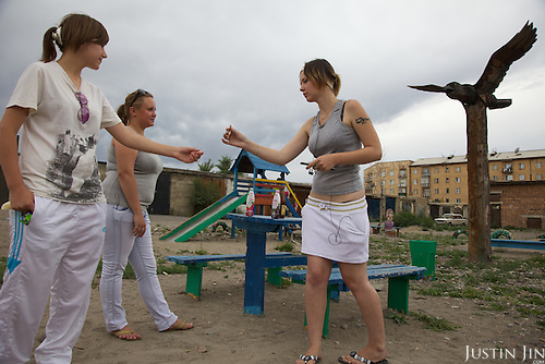 Youths hang around on the street in Kyzyl, capital of Tuva Republic, southern Siberia, Russia
