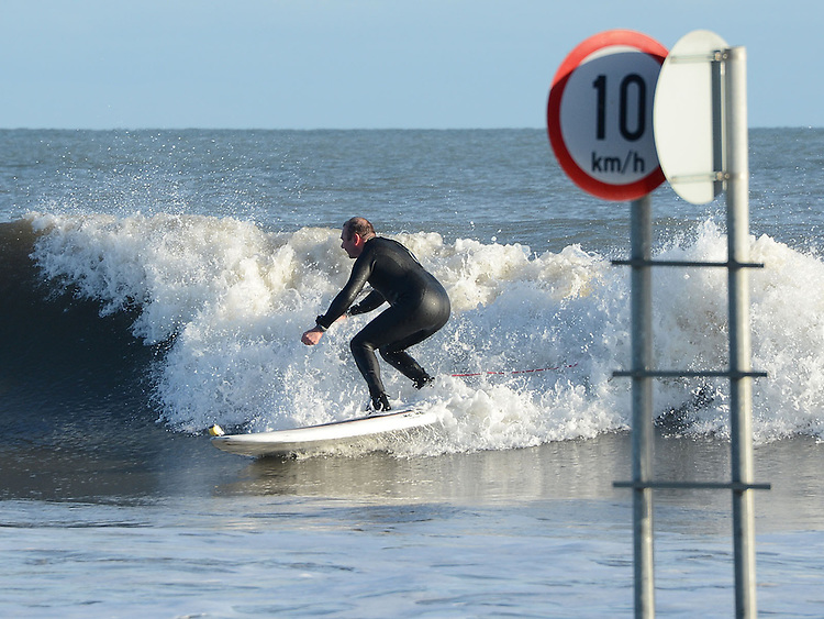 Surfing on the large waves at high tide at Bettystown beach on Saturday morning. Photo: Colin Bell/pressphotos.ie