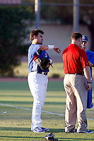 Geovany Soto - AZL Cubs (2009 Arizona League) - Major league catcher Geovany Soto stretches before his first injury rehab game against the AZL Rangers at the Cubs training complex at Fitch Park, Mesa, AZ - 08/01/2009..Photo by:  Bill Mitchell/Four Seam Images..