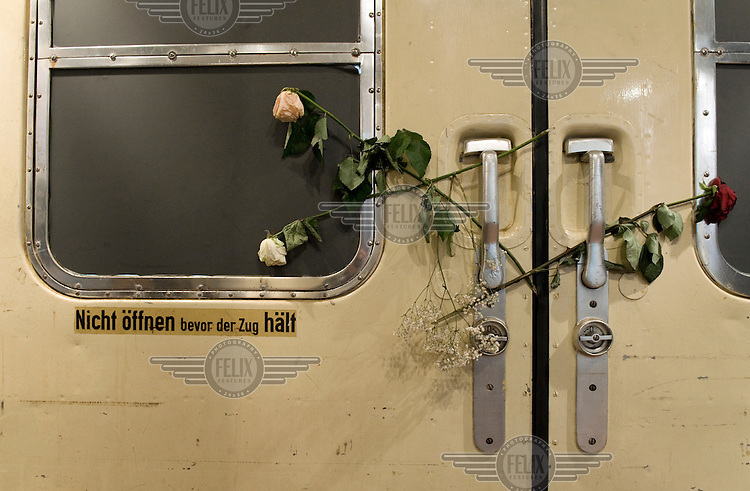 Roses adorn the carriage doors of the 'Zug der Erinnerung', The Train of Remembrance, at Berlin's Ostbahnhof station. The train features a mobile exhibition on the deportation of Jewish children from all over Europe to concentration camps during the Second World War (WWII). The attitude of Germany's state owned railway company Deutsche Bahn caused controversy after the moveable exhibition was refused permission to stop in Berlin's central station.
