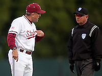 STANFORD, CA - April 12, 2011: Head coach Mark Marquess of Stanford baseball argues a close call at first with the first base umpire during Stanford's game against Pacific at Sunken Diamond. Stanford won 3-1.