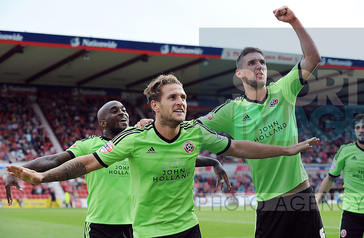 Billy Sharp of Sheffield United celebrates scoring his goal to make it 2-0 with team mate Chris Basham of Sheffield United<br /> - English League One - Swindon Town vs Sheffield Utd - County Ground Stadium - Swindon - England - 29th August 2015<br /> --------------------
