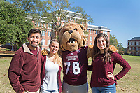 Students posing with Bully mascot on the Drill Field.<br />  (photo by Beth Wynn / &copy; Mississippi State University)