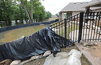 NWA Democrat-Gazette/DAVID GOTTSCHALK A flooded pool is visible Tuesday, June 4, 2019, outside a residence on Turtle Bay Drive in Fort Smith. Homes in the neighborhood are beginning the process of recovering following flooding by the Arkansas River.