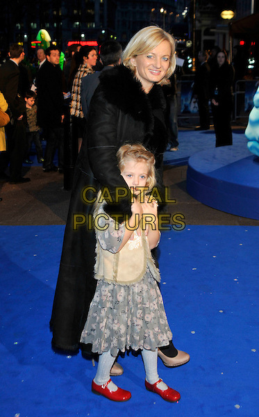 ALICE BEER & DAUGHTER .'Monsters vs Aliens' UK film premiere arrivals.Vue West End cinema, Leicester Square, London UK.11th March 2009..full length black coat child fur collar red shoes mary janes  sheepskin long maxi .CAP/PL.©Phil Loftus/Capital Pictures