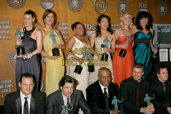 "ELLEN POMPEO, KATE WALSH, CHANDRA WILSON, SANDRA OH, KATHERINE HEIGL, SARA RAMIREZ, T.R. KNIGHT, JUSTIN CHAMBERS, PATRICK DEMPSEY, JAMES PICKENS JR. & ERIC DANE,  cast of ""Grey's Anatomy"".13th Annual Screen Actors Guild (SAG) Awards held at the Shrine Auditorium - pressroom,  Los Angeles, California, USA, 28 January 2007..press room half length awards trophies .CAP/ADM/RE.©Russ Elliot/AdMedia/Capital Pictures."