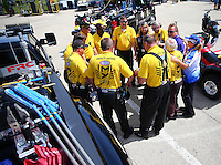 Jul 10, 2016; Joliet, IL, USA; Members of the NHRA safety safari crew pray prior to the Route 66 Nationals at Route 66 Raceway. Mandatory Credit: Mark J. Rebilas-USA TODAY Sports