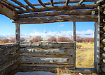 Idaho, Eastern, Leadore, Birch Creek Valley. Birch Creek and the Lemhi Mountains in early spring viewed from inside an old pioneer structure.