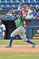 Lexington Legends shortstop Humberto Arteaga (23) swings at a pitch during a game against the Asheville Tourists on May 3, 2015 in Asheville, North Carolina. The Legends defeated the Tourists 6-3. (Tony Farlow/Four Seam Images)