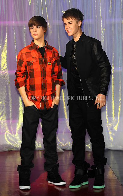 WWW.ACEPIXS.COM . . . . .  ..... . . . . US SALES ONLY . . . . .....March 15 2011, London....Popstar Justin Bieber poses with his new waxwork at Madame Tussauds on March 15, 2011 in London, England. ....Please byline: FAMOUS-ACE PICTURES... . . . .  ....Ace Pictures, Inc:  ..Tel: (212) 243-8787..e-mail: info@acepixs.com..web: http://www.acepixs.com
