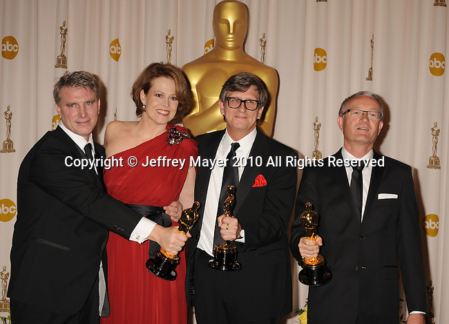 HOLLYWOOD, CA. - March 07: Presenter Sigourney Weaver (second from left) poses with Art Directors Robert Stromberg, Rick Carter, Kim Sinclair pose in the press room at the 82nd Annual Academy Awards held at the Kodak Theatre on March 7, 2010 in Hollywood, California.