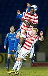 St Johnstone v Hamilton Accies....02.02.11  .Tom Elliott and Ziggy Stardust get clattered by Murray Davidson.Picture by Graeme Hart..Copyright Perthshire Picture Agency.Tel: 01738 623350  Mobile: 07990 594431